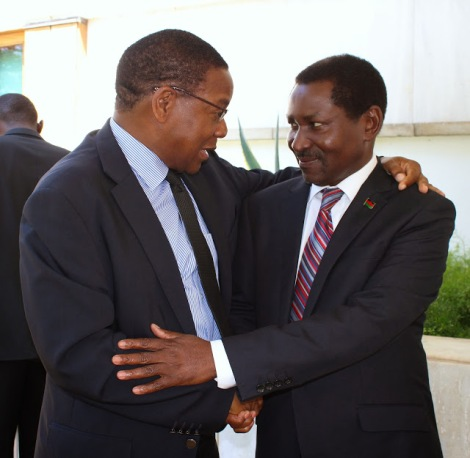 Bernard Membe and Ephraim Chiume, Ministers of Foreign Affairs and International Cooperation for Tanzania and Malawi, embrace after submission of written reply on territorial dispute concerning Lake Malawi (Photograph courtesy of)