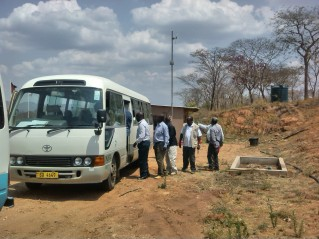 Parliamentarians boarding bus at Kayelekera Mine entrance, Paladin Africa