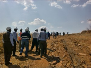 Kayelekera Uranium Mine. Parliamentarians, Journalists and Mine Employees take a look at the open pit