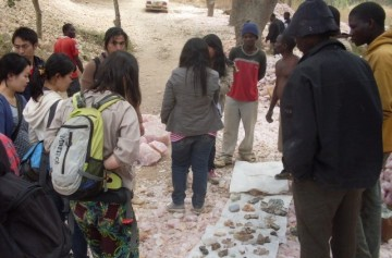 Miners selling different kinds of gemstone samples to tourists (Photo taken by Chikomeni Manda)