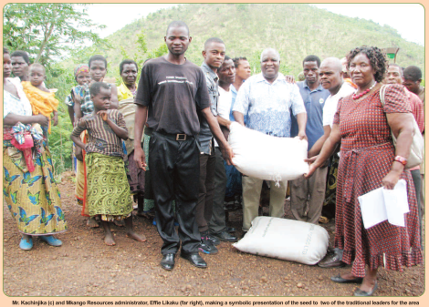 Mkango Resources presents seeds to traditional leaders in TA Nazombe (Image taken from the Mining Review January 2015, page 6 and 7)